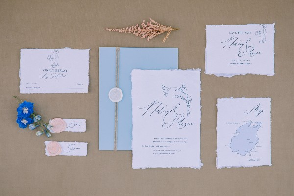 Greek wedding invitations stationery on brown background