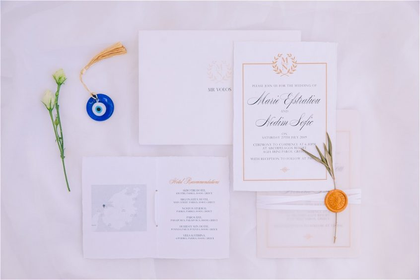 White wedding stationery with favours