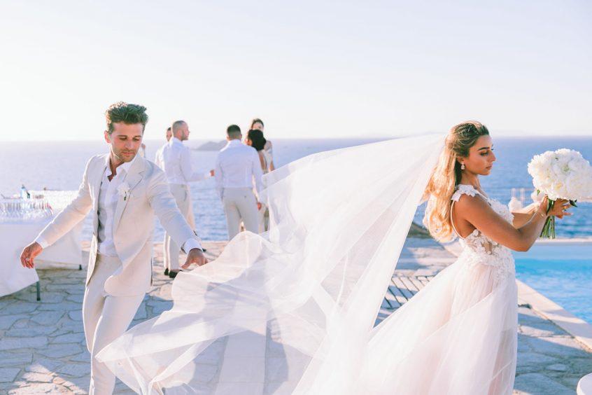 Groom and bride in white wedding veil