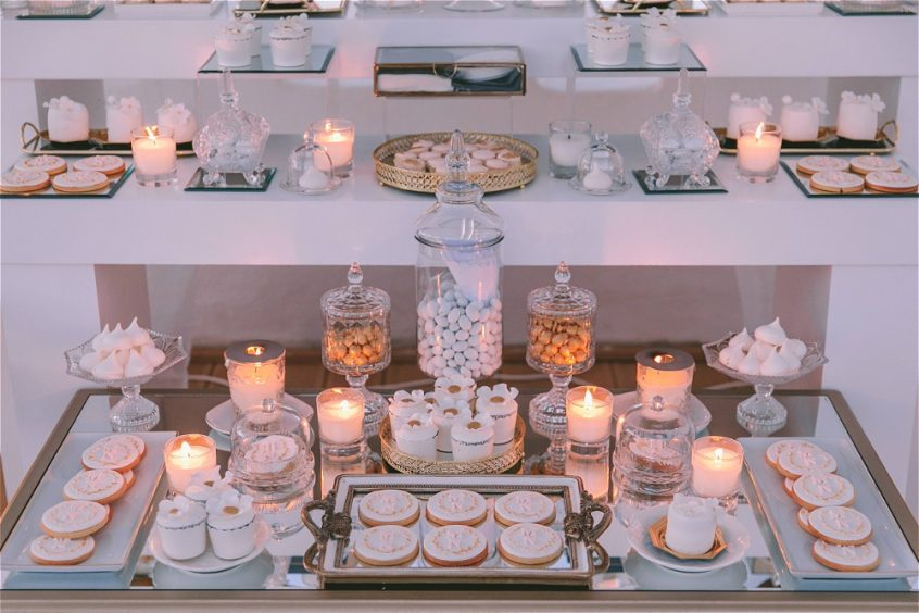 Beautifully decorated candy bar by wedding designer