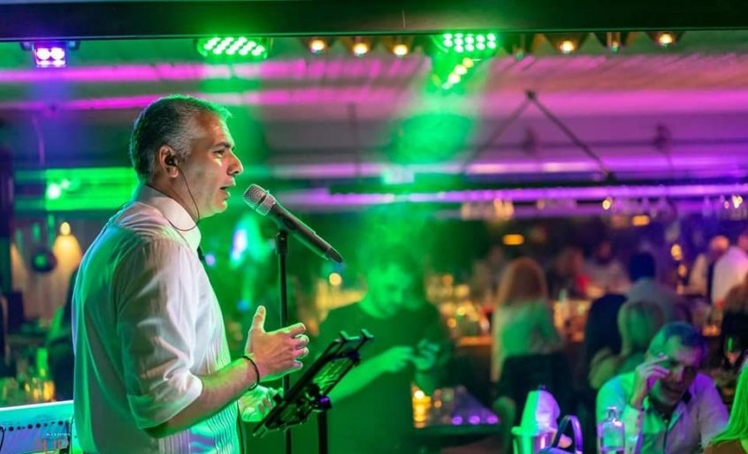 Wedding Greece Kostas Fiotakis singing with microphone