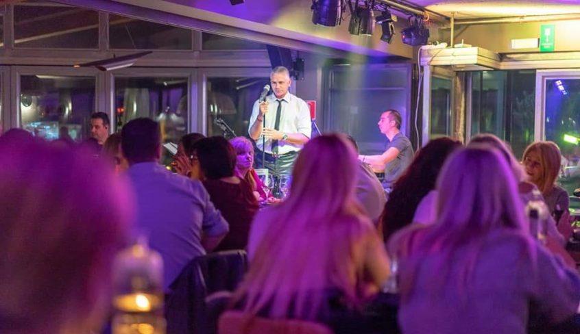 Greek wedding band Kostas Fiotakis singing in front of crowd