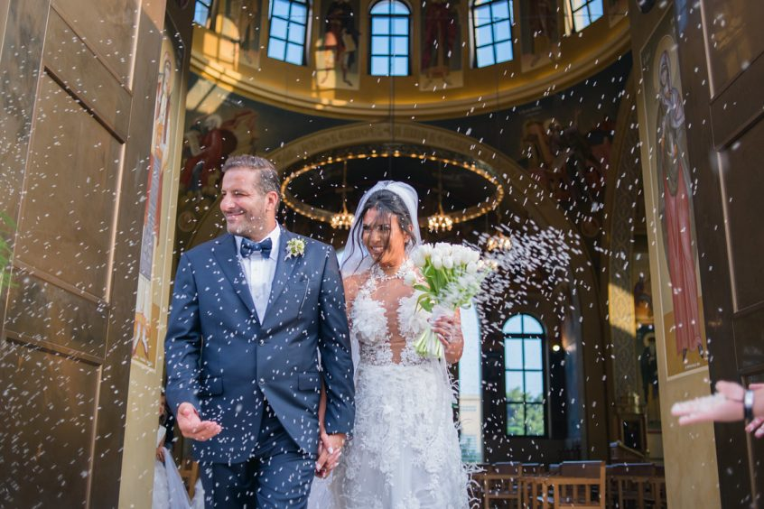 Getting married in Greece at a church while rice is thrown