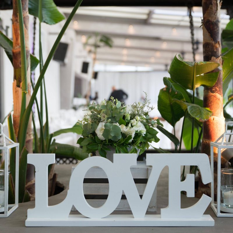 White Love decorative wooden sign with letters.