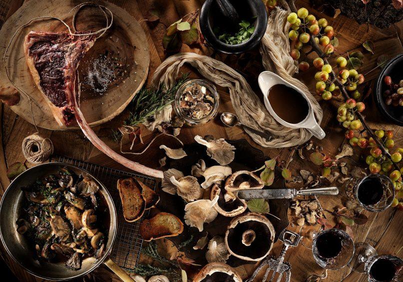 Deipnosofistirion`s wedding catering dishes on wood table