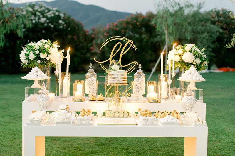 candy bar with flowers and candles