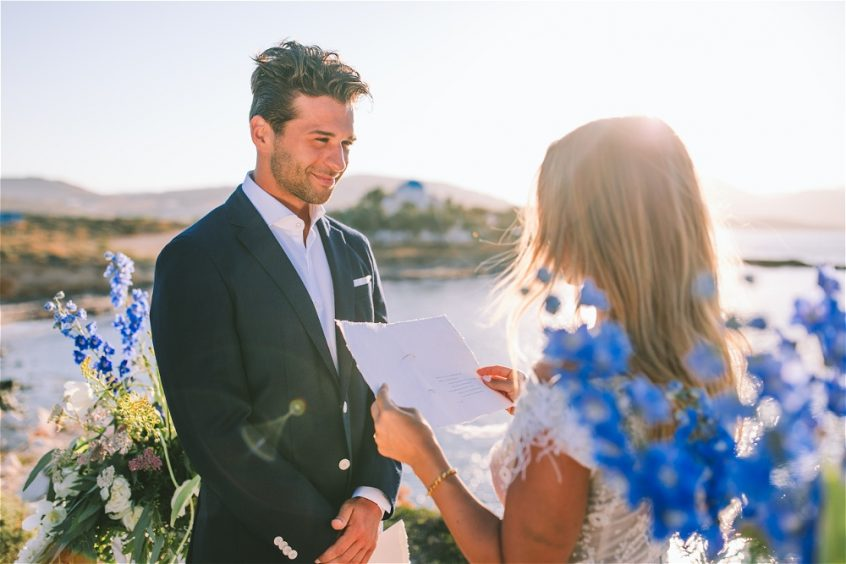 bride and groom getting married surrounded by flowers